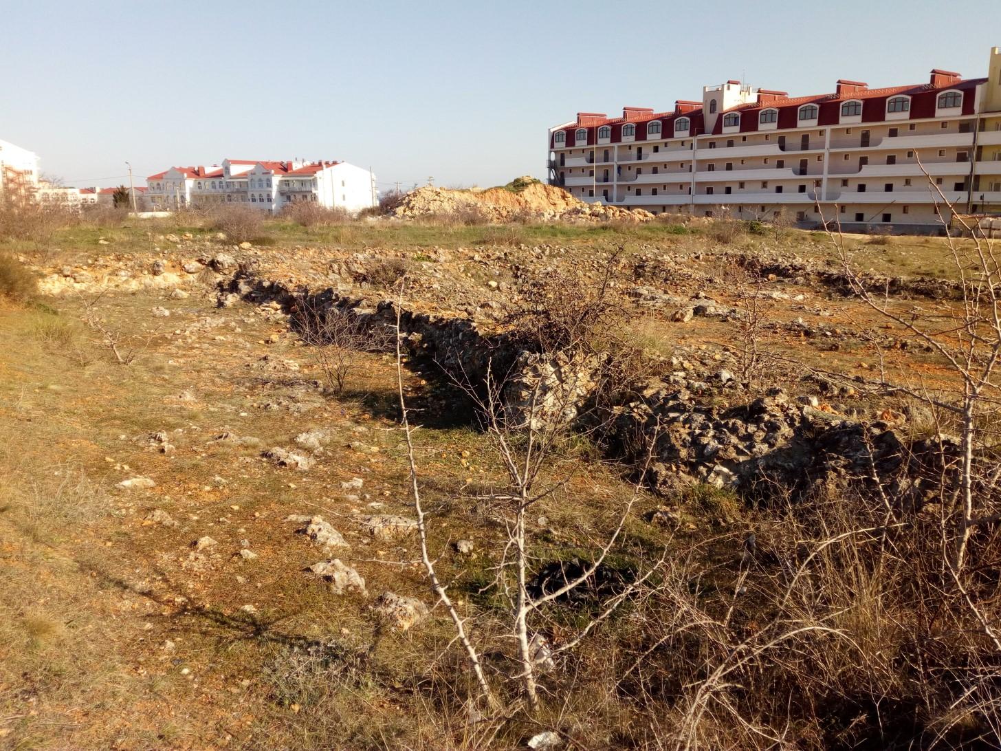 Плантажные стены около бухты омега
